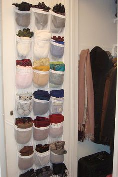 On the inside of the coat closet door, for scarves, hats, and gloves.