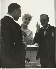 Marilyn with novelist Truman Capote, c. 1955.