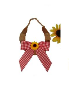 Rusty horseshoe decorated with twine, red gingham bow and sunflower! Perfect, lucky decor for home or barn!