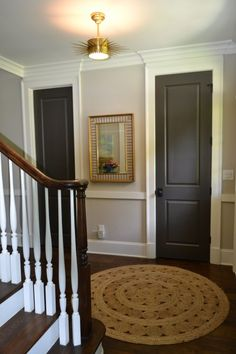 Warm gray, neutral... walls are Benjamin Moore(BM) Revere Pewter and the trim is BM White Dove. On the main floor, they used dark doors for contrast and handprint-hiding.