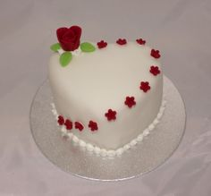 Individual Heart Cake with edible red flowers and rose. Red/white