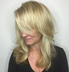 Medium Layered Blonde Hairstyle With Bangs