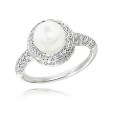 really unique swapping the diamond for a pearl! paired with a gorgeous diamond wedding band this would be amazing!