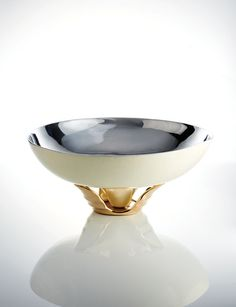 Nima Oberoi Lunares Orpheus Gold in polished silver and gold. This gorgeous two tone bowl will become a timeless part of your home decor, table setting while you're entertaining guests at a party, or a stunning gift for any occassion.
