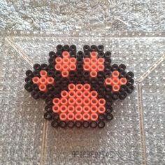 An adorable paw print #perler #perlers #pixelart #perlerbead #perlerbeads #paw #pawprint #perlerpaw #perlerbeadpaw #cutepaw #cutepawprint #perlerpawprint #pinkpaw #pinkpawprint