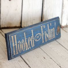 Hooked on Fishing - Reclaimed, painted and distressed wood sign - Rustic, Home Decor, Wall Art, Man Cave Decor. $30.00, via Etsy.