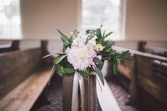 Floral design by A to Zinnias (pew hangs) Photo By Krista Turner Photography