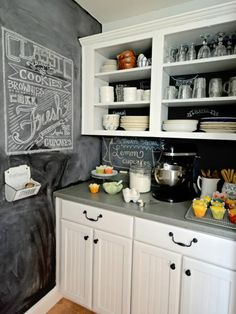 chalkboard wall and backsplash in kitchen. Love the removed cabinet doors for open shelving. Such a great way to get a custom look in a home!