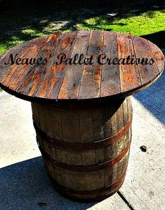 """NO LONGER AVAILABLE: Does this say """"Man Cave"""" to anyone else? We took an old Whiskey Barrel and topped it with oak planks from a pallet. It is stained and we are selling it for $175. It is 36"""" high and 36"""" in diameter. We can make stools to complete the set if you ask. Message us if you are interested in this indoor/outdoor, rustic, poker-playing, beer guzzling, crawfish eating table! (We only have two of these.) Item # 636"""