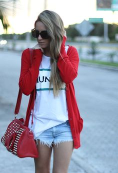 shorts, white tee and red cardigan.
