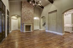 Great Room also has vaulted ceilings, reclaimed brick fireplace with stone mantle.