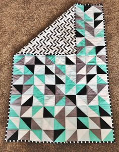 Quilt. half square triangle quilt. I really do like this. A restricted colour palette, geometric print for the backing makes for a modern and vibrant bed quilt. Might have to do this one sometime.............
