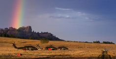 Black Hawk helicopters sit unused at Fort Robinson State Park at sunset as the fires calm and rain hits Dawes County, helping firefighters to contain the fires. MARK DAVIS/THE WORLD-HERALD
