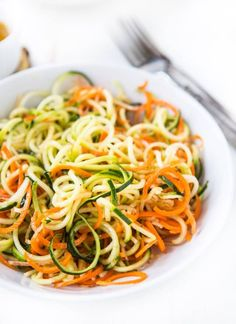 This fun Vegetable Zoodle Salad with a refreshing lemon vinaigrette will keep you cool all summer long. (#recipe by A Zesty Bite)