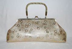 Perfect for spring!  I've been wanting a new handbag and this vintage one is awesome!  Vintage Gold Cream Metallic Glitter Handbag - Glitter Lucite Handle - Mid Century Mod Handle Purse - Pearlized Vinyl Fabric - Retro Design