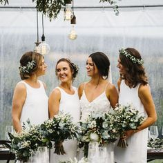 bridesmaids with green and white bouquets