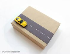 great gift wrap for a boy..love the car on the outside of the box..could easily adapt this idea..