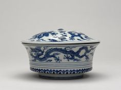 Porcelain bowl with domed cover, decorated in underglaze cobalt blue. Two five-clawed dragons among clouds on the sides and also on lid. Marks inside lid and bowl. Ming dynasty 15th century. Xuande period.
