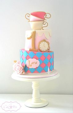 Alice in Wonderland-themed cake for a little girl's first birthday