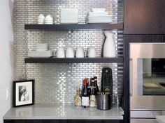 29 Top Kitchen Splashback Ideas for Your Dream Home - Stainless Steel Tile Splashback Would you like to update your kitchen without undergoing a full remodel? Check out our top kitchen splashback ideas to get inspiration! Backsplash Herringbone, Glass Tile Backsplash, Backsplash Ideas, Splashback Ideas, Tile Ideas, Stainless Backsplash, Beadboard Backsplash, Removable Backsplash, Wall Tiles