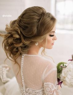 Gorgeous low updo wavy wedding hairstyle; Featured Hairstyle: ElStyle