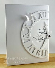 Weathered Clock die by Tim Holtz on my card - layering it on the white panel with foam tape