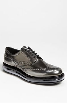 A transparent sole grounds a futuristic wingtip shoe clad in a polished mineral-sheen leather.  Leather upper and lining/rubber and synthetic sole.  Imported.  Men's Shoes.
