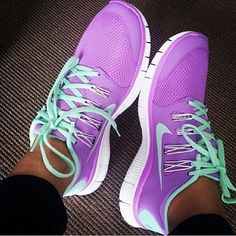 Aqua purple Nike shoes.