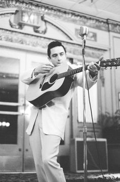 Johnny Cash struttin' his stuff, jammin' on his Martin guitar, CA. 1959.