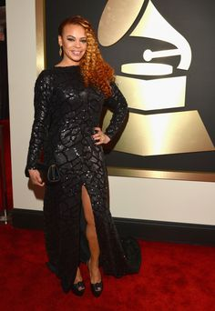 GRAMMY nominee Faith Evansarrives at the 56th Annual GRAMMY Awards on Jan. 26 in Los Angeles