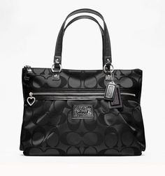 14.  COACH Daisy Signature Tote . Starting at $45 on Tophatter.com!