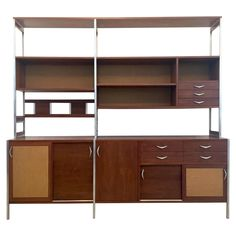 Teak Danish Modern Shelving Wall Unit   From a unique collection of antique and modern shelves at https://www.1stdibs.com/furniture/storage-case-pieces/shelves/