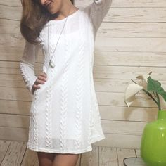 White Sweater Dress Cute and comfy. Has some stretch to it. Size medium but will fit a small for a looser fit. I am wearing a slip underneath because the sweater is sheer. This item is available. Dresses Long Sleeve