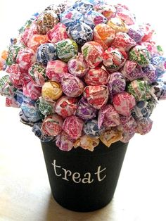 Holiday Lollipop Bouquet - this would be great for birthdays, Drs offices, or any holiday!  I'm going to use tootsie pops for the jewel tones.  And taste!