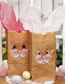 "Easter Bunny Sacks with Tissue Paper Ears: With a simple painting pattern and floppy tissue paper ""ears,"" turn inexpensive paper lunch sacks into Easter bunny bags. Use for decoration at an Easter brunch or egg-hunt."