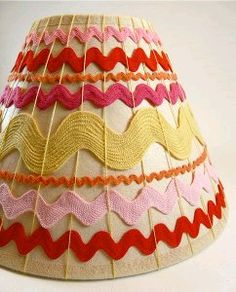 Sister Diane of Crafty Pod (and author of Weaving Un-Loomed) shares a tutorial on Craftzine for this woven ric rac lampshade. A rainbow of ric rac in a variety of sizes is loosely woven around a l… Weaving Projects, Crafty Projects, Crafts To Make, Arts And Crafts, Diy Crafts, Creative Crafts, Rick Rack, Diy Ribbon, Couture