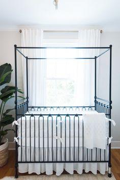 Neutral Baby Nursery with Black Iron Canopy Crib