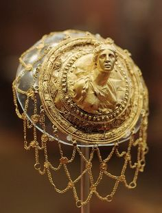 jeannepompadour:  Hairnet with the relief bust of Artemis with quiver. Gold, garnets 3rd cent. B.C. Ancient Grek