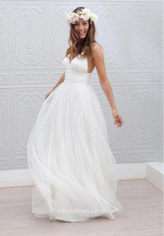 A-line beach wedding dress with sexy v neckline bodice show your ultra-feminine glamor. This sleeveless ivory wedding dress is simply made using soft tulle fabric, spaghetti straps bodice features deep v neckline and wide pleated belted empire waist. Layered tulle floor length skirt finishing off the look. Zip closure open back.  <br><br><br>