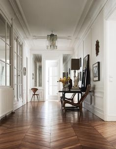 The original parquet floor was concealed beneath green shag carpeting when the Kellers found the apartment. The chandelier is vintage Murano glass.