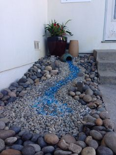 dry creek / spill effect … trying to figure out the shiny blue rocks – are they aquarium rocks?