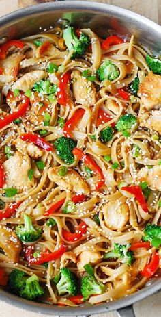 Asian Sesame Chicken & Noodles in a homemade Asian sauce – delish and easy-to-make! Thinly sliced bell peppers, blanched broccoli, grilled or seared chicken, toasted sesame seeds. Recipe via www.bhg.com