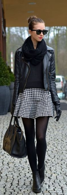 Fall / winter - street & chic style - gray pleated mini skirt + black thights + black heeled ankle boots + black sweater + black leather jacket