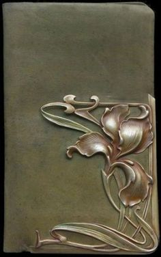 Wallet, ca. 1900. Art Nouveau Jugendstil silver decoration on the leather cover.