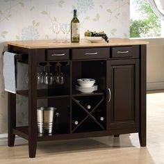 The Kitchen Cart w/ Butcher Block Top is crafted with a solid rubberwood with a butcher block work surface. Finished in natural and cappuccino, it a sophisticated piece for preparation in a kitchen or a server in a dining room or breakfast nook. Make the most of its three drawers, shelving with a stemware rack and a wine bottle holder, door with storage inside, and towel rack to store dishes, silverware, and more.