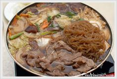 sukiyaki--thinly sliced beef, soba noodles, shitake mushrooms and japanese vegetables served in a stew.