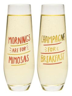 """Stemless champagne glasses feature printed """"Mornings Are For Mimosas"""" and """"Champagne For Breakfast"""" sentiment. Featuring metalic script, this elegant champagne"""