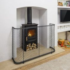 Metal Fireguard for Wood Burning Stove, from Garden Requisites - Bath, England> http://www.garden-requisites.co.uk/products/fireguards/