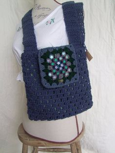 Boho fashion :Hand crocheted, embellished boho style mesenger bag.Lined for extra durability. Retro chic AND practicality:this would make a great gift.. One of a kind design,hand made in Wales. £20.00,available from www.liliwenfachknits.co.uk