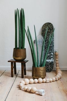 Plants in vintage pots matched with BLESS cable jewelry in the FvF Apartment.